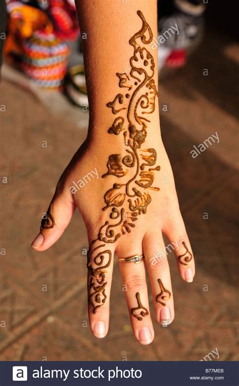 henna tattoo on the hand of a tourist place djemma el fna