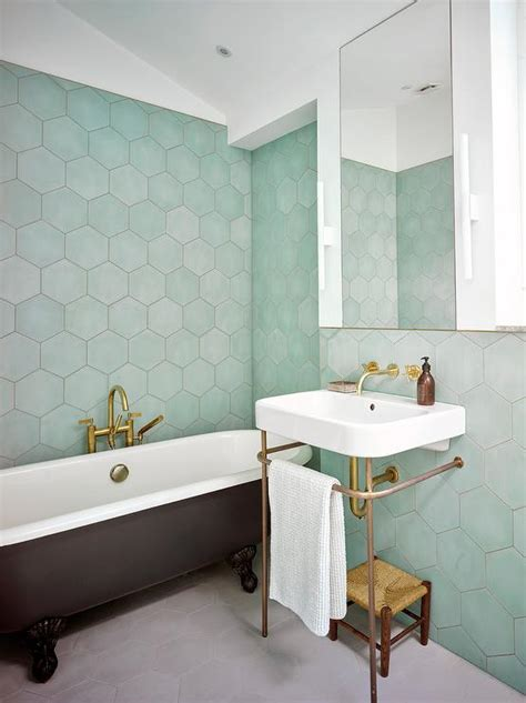 green hexagon tiles with black clawfoot bathtub