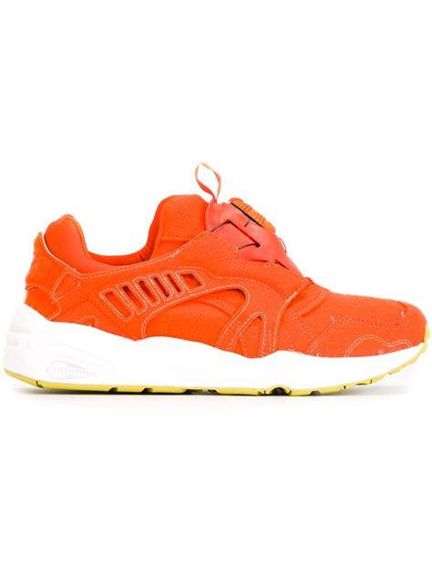 orange sneakers lyst disc blaze sneakers in orange for