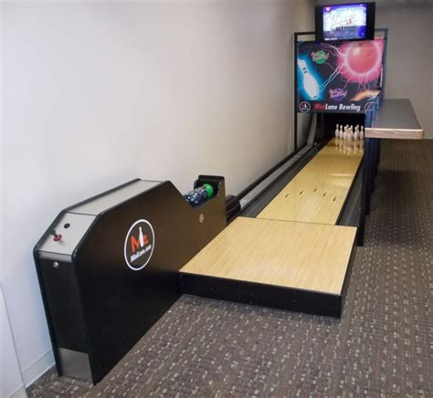 Decorating Ideas For Bedrooms On A Budget a mini bowling alley in a basement of a regular home