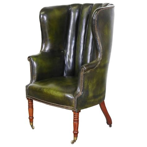 Leather High Back Chair by Vintage Green Leather High Back Wing Chair At 1stdibs