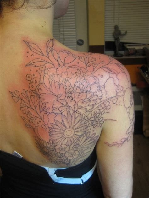small flower tattoos on back shoulder outline flower tattoos on right back shoulder