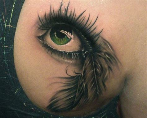tattoo feather with eye green eye with feather tattoo tattooimages biz