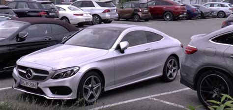 mercedes parking mercedes c class coupe and s class cabriolet in a