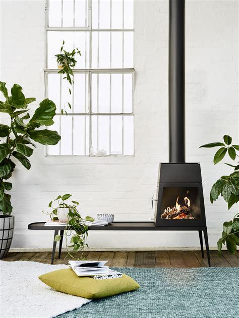 skantherm shaker shaker wood stove by antonio citterio oblica designer