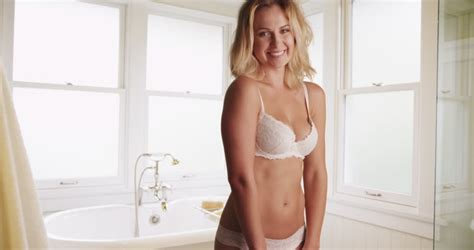 videos of bathroom sex sexy woman standing in white lingerie in bathroom stock