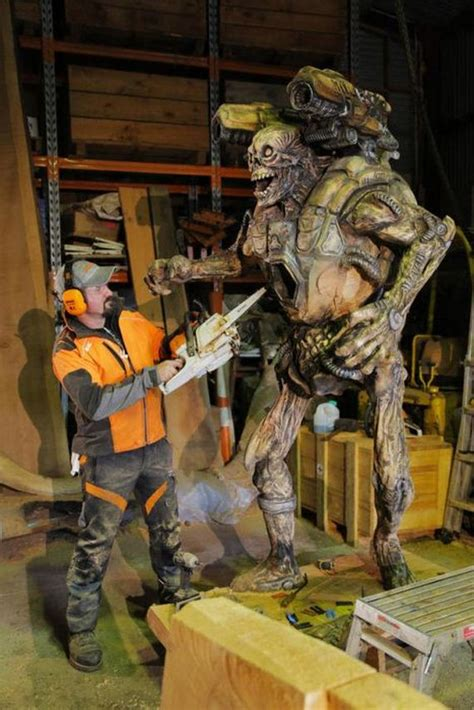 man  chainsaw  create demon sculpture revenant  doom barnorama