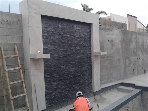 imagenes de muros llorones minimalistas foto muro lloron cortina de agua y fuentes con fuego en