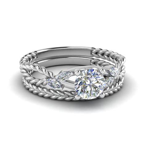 cut wispy vine marquise bridal ring sets in