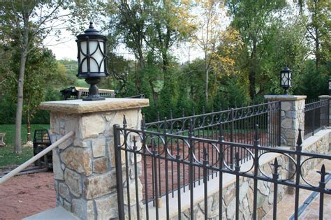 Elegant Backyard Wrought Iron Fence With Natural Stone And