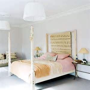 white master bedroom with four poster bed white bedroom