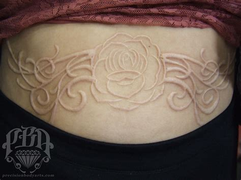 precision tattoo healed scarification by ouellette at precision