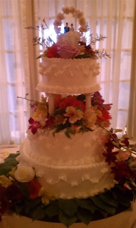 White with pillars and flowers wedding cake  3 tiered