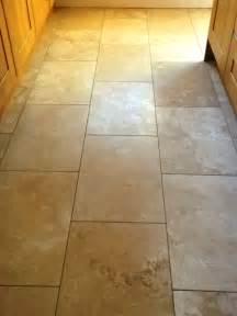 restoring the shine on a travertine floor tiles in