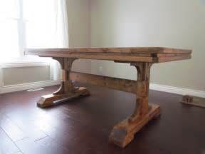 rectangular unstained woooden dining table with wooden