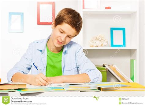 Do Home Work by Smart Handsome Boy Write In Textbook Do Homework Stock