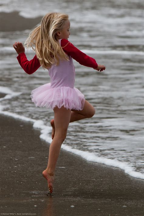 little girls ballet dancing cute little girl in pink dances on beach during the kite f