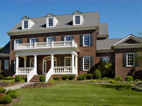 colonial brick homes colonial brick house with black shutters hgtv