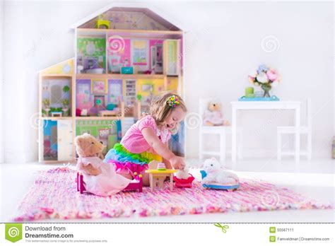 little girl house kids playing with stuffed animals and doll house stock photo image 55567111