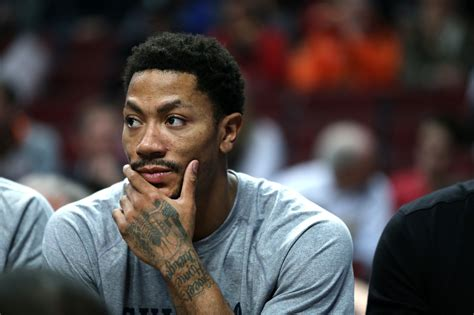 derrick rose on bench rose to undergo surgery after suffering facial fracture the bulls times