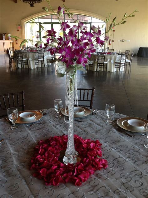 eifflel tower vase  orchids  pearls  full rose petal base   fall wedding table