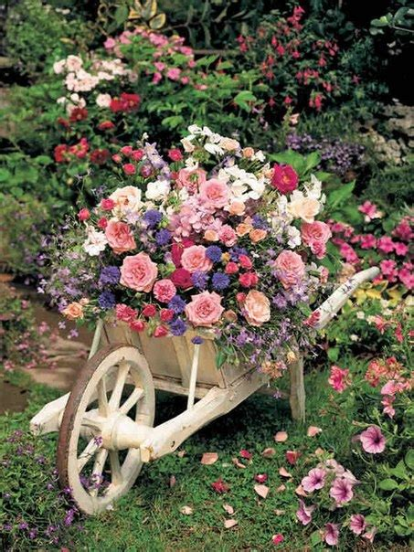 use an old wheelbarrow as a planter home design garden