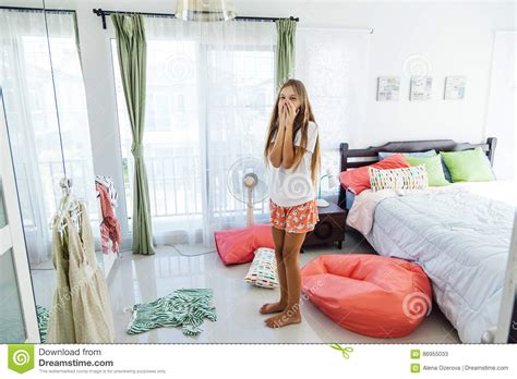 bedroom outfits for her teenage girl choosing clothing in closet stock image