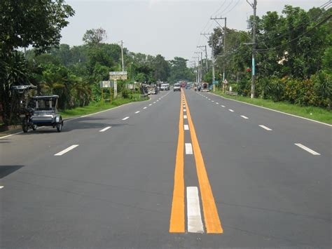 widening concreting  calamba sta cruz famy junction