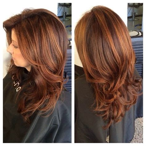 deep layers haircut heavy layered long haircut deep copper red base with a