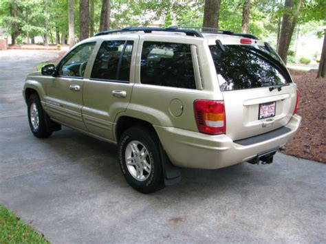 2000 gold jeep grand cherokee 1j4gw58n8yc370059 2000 gold jeep grand cherokee limited