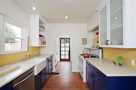 blue and yellow kitchen ideas eclectic kitchen with blue cabinets and yellow tile