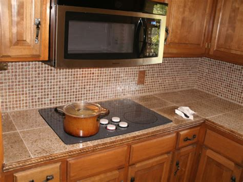 Updating Kitchen Countertops by Kitchen Update With Ceramic Tile Countertop And Glass Tile