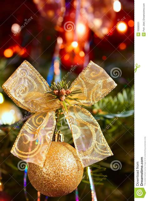 gold ribbons on christmas trees detail gold and ribbon on tree stock image image 10908331