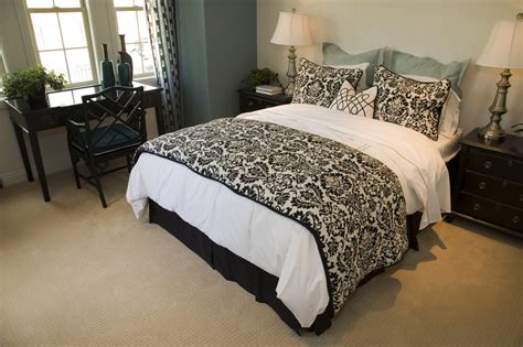 50 professionally decorated master bedroom designs photos a small bedroom featuring a gilded black and white bed set