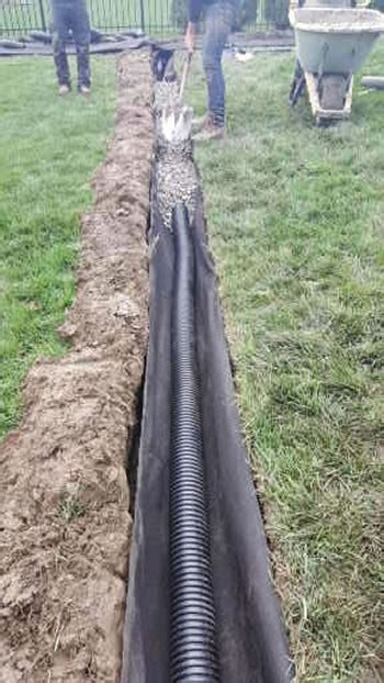 curtain drain construction why corrugated pipe is used when building a michigan