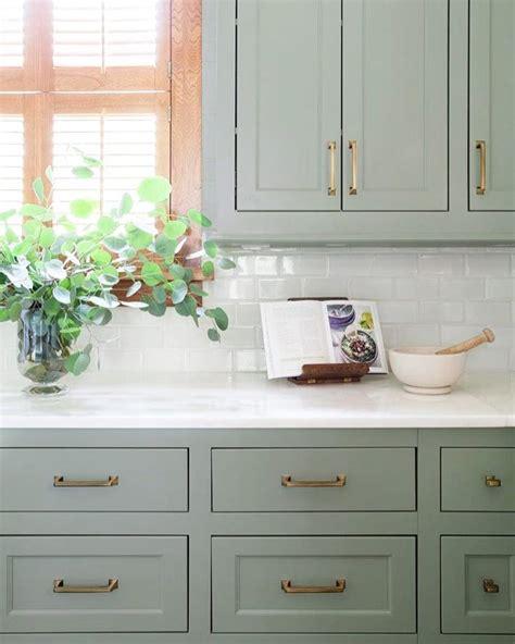 backsplash for kitchen walls green cabinets marble counters subway backsplash brass hardware classic kitchens