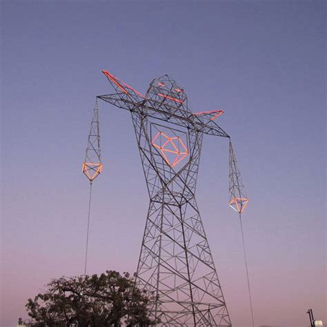 Lamp Squid by Electrical Tower That Looks Like A Giant Robot