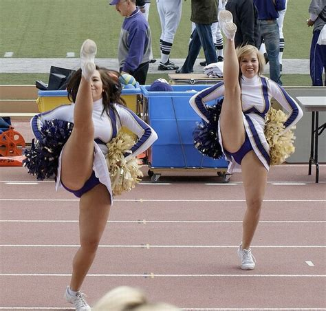 Sexy Cheerleaders High Kicking