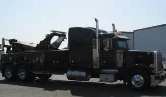 Tow Truck Towing by Tractor Trailer Tire Towing Services