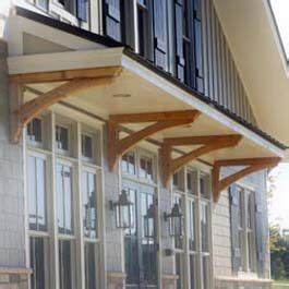 roof overhang supported  stained cedar bracket supports