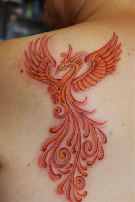 phoenix tattoo on hip phoenix tattoo love the color work i would put it on my
