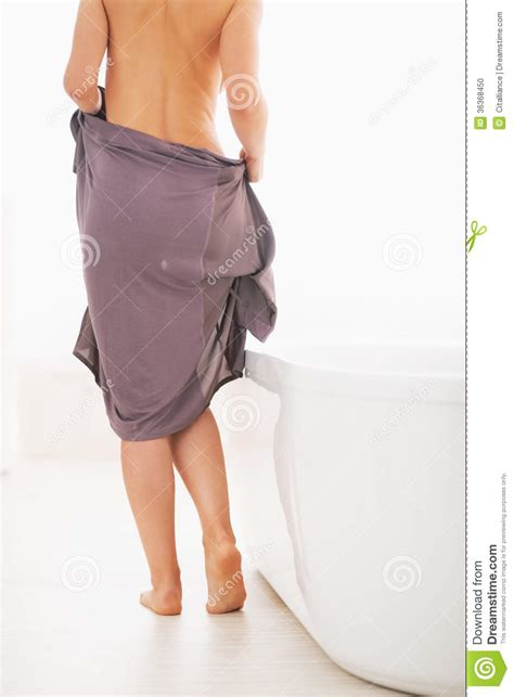 girls undressing in bathroom closeup on young woman undressing to take a bath stock