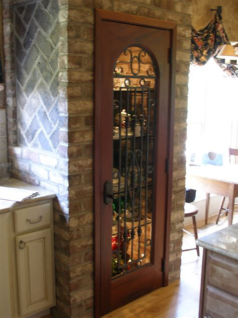 impressive brown wooden pantry doors ideas with black