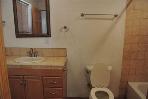 combine two basic bathrooms that a wall to