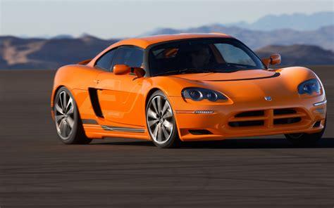 orange sports cars machinery orange sport car road mountains dodge