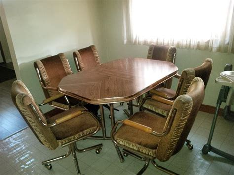 kitchen table w leaf and 6 swivel chairs east