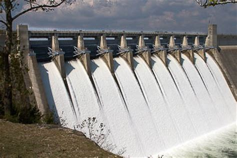 design flood meaning spillway definition types classification of spillway