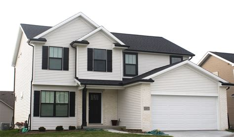 black siding houses back roof mastic linen siding white trim black gutters in bloomington il carlson