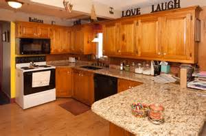 countertops with oak cabinets oak cabinets with granite countertops