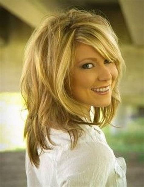 Tag medium length hairstyles with layers and side swept bangs hairstyle hits pictures